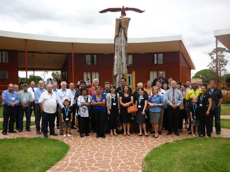 Workshop participants gather in the main circle at the newly constructed Wiradjuir Study Centre, Condobolin.  They are in front of  an original Lake Cowal scar tree topped by an eagle carved by Adam Umphries and designed by Percy Knight. The eagle symbolizes the spiritual journey of Aboriginal people and the quest of reconnection with passed loved ones. D. G.