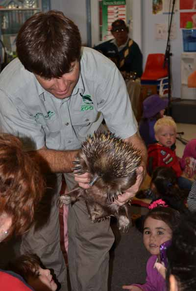 Rod Cheal providing an up close and personal experience with a very friendly echidna for the children of St Josephs, Condobolin.