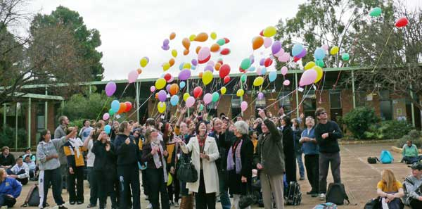 Condobolin High School students released hundreds of helium filled balloons to honour the memory of one of their favourite teachers, Miriam Helby.