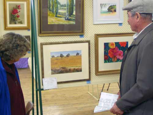 Visitors view the artwork entries at Blue Water Art & Craft Exhibition in Lake Cargelligo.