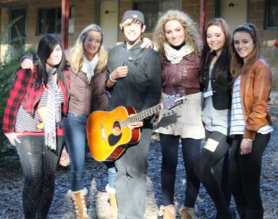 Condobolin High School music students with teacher Cathy Saxby and country music star Katrina Burgoyne.