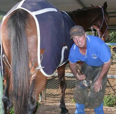 Local Condobolin farrier Graham (Spud) Whiley, fitting 'Merlin' with some new shoes. OM
