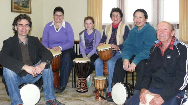 Djembe teacher Mark Bennet with students Sharron Haase, Eliza Packham, Heather Blackley, Lanny MacKenzie and Bill Cunningham. DG