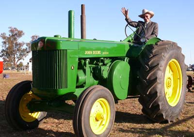 Allan Helyar and an old John Deere tractor at a past Condobolin Show. Old tractors like these don't have the safety features of modern machinery.