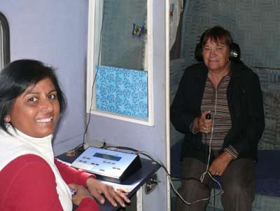 Central West Manager for Australian Hearing, Sunila Kumar, checks Delma Brennan's hearing. DG
