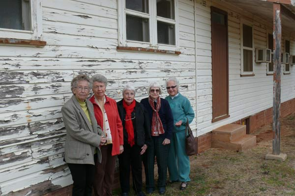 Members of the United Hospitals Auxiliary Condobolin Branch outside Condobolin Hospital's dilapidated nursing quarters. L-R: Mary Glen, Jill Broadley, Dawn Thomas, Francis Gavel and Joan Jamieson. DG