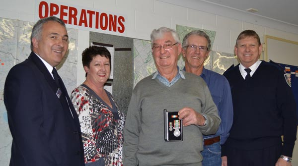 Awarded for sixty years of firefighting: Paul Smith (Regional Manager of Region West RFS), Deputy Mayor Lachlan Shire Kim Jones, Brian Terry, Doug Ridley and Ken Neville (Manager Mid Lachlan Valley Team RFS). Photo: Karen Tooth.
